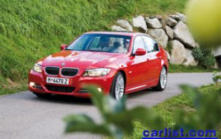 2009 BMW 335d driving up the hill