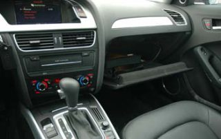 The glovebox contains audio connections for an MP3 player