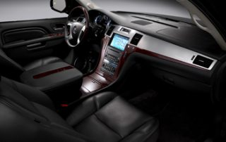 Platinum model interiors are adorned with stitched leather, polished wood, and three video displays