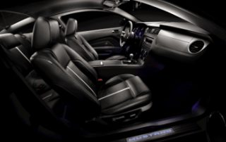 The bucket seats look like the early Mustang designs but adjust like 21st century seats