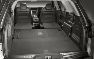 Acadia's passenger compartment has room for three rows of folding seats and a rear bay for cargo
