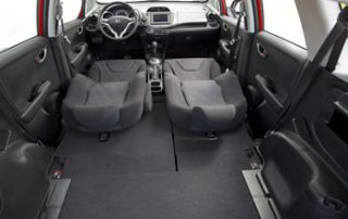 "The ""Magic Seat"" folds down flat to create a rear cargo volume of 57.3 cubic feet"