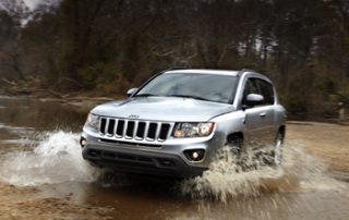 The Compass wears familiar hallmarks of Jeep, such as the seven-slot grille and large round headlamps