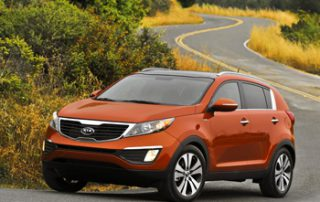 "The Sportage wears Kia's new ""tiger nose"" tabbed grille up front with a dramatically sweeping lower fascia"