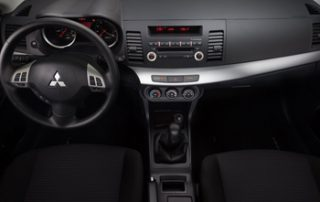 The dash has a twin-pod shape over the gauges - evoking an Alfa Romeo, while the main dash panel flares towards you like that in a BMW