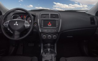 Inside you'll find cloth seats, a leather-wrapped steering wheel, and padded dash and door panels