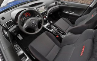 The interior of the WRX is all about driving, with seats that hug the body and aluminum pedals that grip the feet