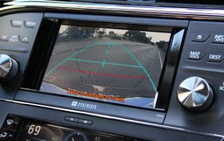 a backup camera to help manuever out <BR>of the garage without slicing off a mirror