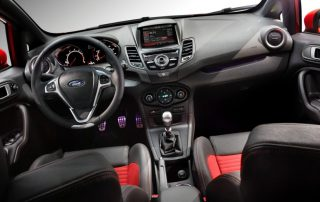 a leather-wrapped steering wheel and leather-trimmed shift knob.